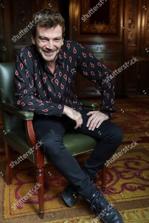 Stock Photo of Argentinian actor and cast member Guillermo Pfening poses for photographer as he is interviewed during the presentation of the film 'Nadie nos mira' (Nobody's Watching) in Madrid, Spain, 20 June 2018. The Argentinian film, directed by Julia Solomonoff, will open in Spanish cinemas on 22 June.
