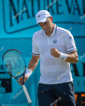 Gilles Muller (LUX) celebrates a wining point during his match against Marin Cilic (CRO).  Fever-Tree Tennis Championships, Queens Tennis Club, London, England, 20th June 2018.