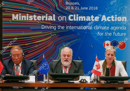 Special Representative for Climate Change Xie Zhenhua, China (L) EU Commissioner for Energy and Climate Action Miguel Arias Canete (C) and Climate Change and Environment Minister Catherine McKenna, Canada (R) attend the second  Ministerial on climate action at Egmond Palace in Brussels, Belgium, 20 June 2018. The second Ministerial on Climate Action (MoCA) taking place on 20 - 21 June 2018 will be attended by ministers and high-level representatives from over 35 countries, including ministers from the G20 and chairs of key party groupings in the UN climate negotiations.