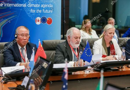 Stock Photo of Special Representative for Climate Change Xie Zhenhua, China (L) EU Commissioner for Energy and Climate Action Miguel Arias Canete (C) and Climate Change and Environment Minister Catherine McKenna, Canada (R) attend the second  Ministerial on climate action at Egmond Palace in Brussels, Belgium, 20 June 2018. The second Ministerial on Climate Action (MoCA) taking place on 20 - 21 June 2018 will be attended by ministers and high-level representatives from over 35 countries, including ministers from the G20 and chairs of key party groupings in the UN climate negotiations.