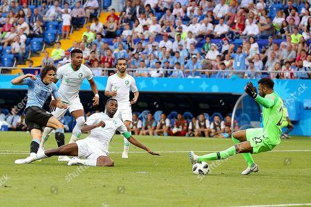 Goalkeeper Mohammed Al-Owais of Saudi Arabia saves the shot by Edison Cavani of Uruguay