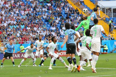 Goalkeeper Mohammed Al-Owais of Saudi Arabia fails to clear the ball prior to Luis Suarez of Uruguay scoring the first goal