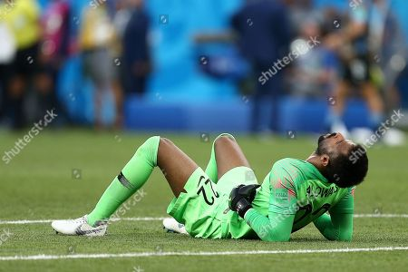 Goalkeeper Mohammed Al-Owais of Saudi Arabia shows a look of dejection at the final whistle