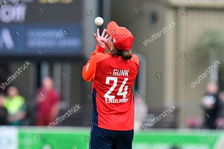 Stock Photo of Wicket - Jenny Gunn of England taking the catch to dismiss Laura Wolvaardt of South Africa off the bowling of Katherine Brunt of England during the International T20 match between England Women Cricket and South Africa at the Cooper Associates County Ground, Taunton. Picture by Graham Hunt