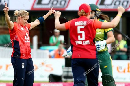 Stock Photo of Katherine Brunt of England celebrates taking the wicket of Laura Wolvaardt of South Africa with a catch from Jenny Gunn.