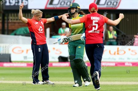 Katherine Brunt of England celebrates taking the wicket of Laura Wolvaardt of South Africa with a catch from Jenny Gunn.