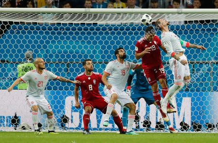 Sergio Ramos, Majid Hosseini. Spain's Sergio Ramos, right and Iran's Majid Hosseini, second from right, compete for the ball during the group B match between Iran and Spain at the 2018 soccer World Cup in the Kazan Arena in Kazan, Russia
