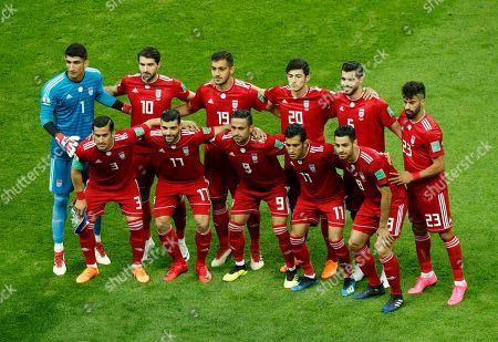 Iran's starting players pose for a team photo at the beginning of the group B match between Iran and Spain at the 2018 soccer World Cup in the Kazan Arena in Kazan, Russia, . Front row, from left, are Ehsan Haji Safi, Mehdi Taremi, Omid Ebrahimi, Vahid Amiri, Morteza Pouraliganji. Back row, from left, are goalkeeper Ali Beiranvand, Karim Ansarifard, Majid Hosseini, Sardar Azmoun, Saeid Ezatolahi, and Ramin Rezaeian