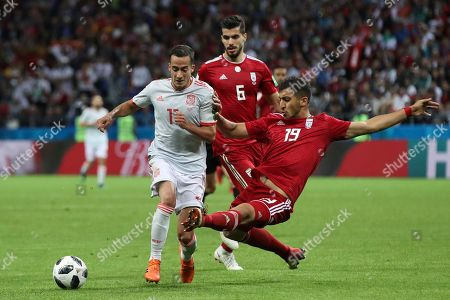 Spain's Lucas Vazquez, left, fights for the ball with Iran's Majid Hosseini during the group B match between Iran and Spain at the 2018 soccer World Cup in the Kazan Arena in Kazan, Russia
