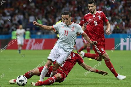 Spain's Lucas Vazquez, top, fights for the ball with Iran's Majid Hosseini during the group B match between Iran and Spain at the 2018 soccer World Cup in the Kazan Arena in Kazan, Russia