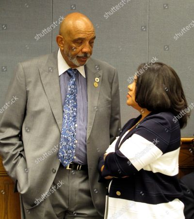 State Rep. Terry Landry, D-New Iberia, left, speaks with Revenue Secretary Kimberly Robinson ahead of the House Ways and Means Committee meeting, in Baton Rouge, La