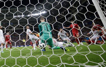 Iran's Saeid Ezatolahi scores past Spain goalkeeper David De Gea a goal that was later disallowed during the group B match between Iran and Spain at the 2018 soccer World Cup in the Kazan Arena in Kazan, Russia