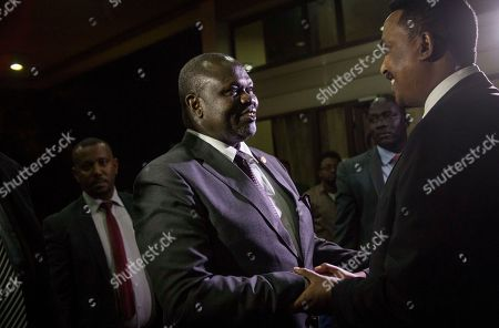 Riek Machar, Workneh Gebeyehu. South Sudan's opposition leader Riek Machar, left, is greeted by Ethiopia's Foreign Minister Dr. Workneh Gebeyehu, right, as he arrives at the office of Ethiopia's Prime Minister for a meeting with South Sudan's President Salva Kiir, in Addis Ababa, Ethiopia . South Sudan's warring leaders met face-to-face for the first time in almost two years on Wednesday amid efforts to end a five-year civil war