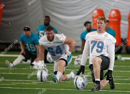 Miami Dolphins offensive tackle Sam Young (79) stretches out during practice at the NFL football team's training camp, in Davie, Fla