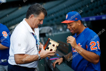 Stock Picture of Keith Hernandez, Dominic Smith. Television announcer Keith Hernandez, left, looks over the mitt of New York Mets first baseman Dominic Smith, who waits warm up for the team's baseball game against the New York Mets, in Denver