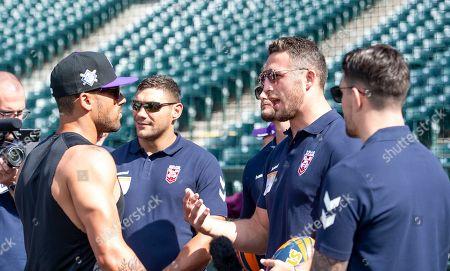 Sam Burgess meets Colorado Rockies players.