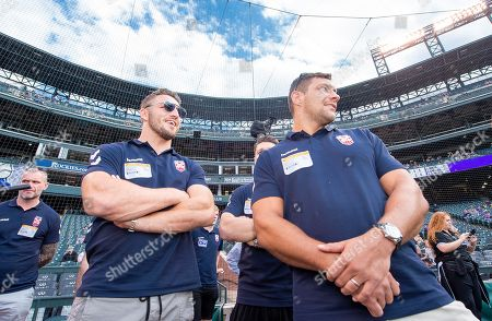 Sam Burgess and Ryan Hall in front of the crowd at Coors Field.