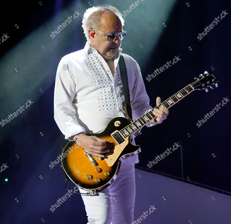 The British-American rock band Foreigner with founder and lead guitarist Mick Jones performs at the Blue Hills Bank Pavilion as part of The Juke Box Heroes Tour, in Boston