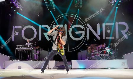 Michael Bluestein, Kelly Hansen, Chris Frazier. The British-American rock band Foreigner with keyboardist Michael Bluestein, lead vocalist Kelly Hansen and drummer Chris Frazier perform at the Blue Hills Bank Pavilion as part of The Juke Box Heroes Tour, in Boston