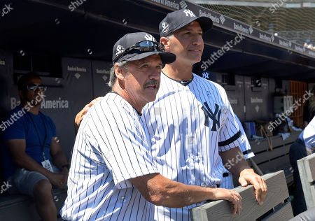 Ron Guidry, Andy Pettitte. New York Yankees' Ron Guidry, left. and Andy Pettitte look on from the dugout before the Yankees Old Timers' Day baseball game, at Yankee Stadium in New York