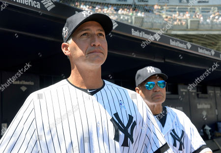 Stock Image of New York Yankees' Andy Pettitte is introduced at the Yankees Old Timers' Day baseball game as Reggie Jackson, right, looks, at Yankee Stadium in New York