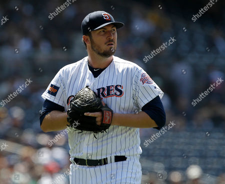 Stock Photo of San Diego Padres relief pitcher Phil Hughes walks off the mound during the seventh inning of a baseball game against the Oakland Athletics in San Diego