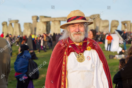 Stock Photo of Rollo Maughfling, the Archdruid of Stonehenge and Britain, at Stonehenge Summer Solstice. An estimated 9500 people gather at the ancient monument of Stonehenge to celebrate the dawn and sunrise on the longest day of the year and the official start of summer. English Heritage provide free public access to the stones each year for the solstice.