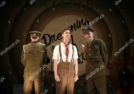 Stock Photo of l-r: William Findley (Goldsmith), Sholto Morgan (Spike), Matthew Devereaux (Bandmaster)