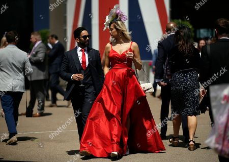 Stock Picture of Harriadnie Beau, right, attends the third day of the Royal Ascot horse race meeting, which is traditionally known as Ladies Day, in Ascot, England . (AP Photo/Tim Ireland