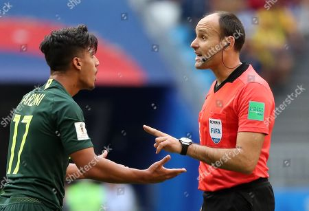 Daniel Arzani of Australia (L) argues with referee Antonio Mateu of Spain during the FIFA World Cup 2018 group C preliminary round soccer match between Denmark and Australia in Samara, Russia, 21 June 2018. (RESTRICTIONS APPLY: Editorial Use Only, not used in association with any commercial entity - Images must not be used in any form of alert service or push service of any kind including via mobile alert services, downloads to mobile devices or MMS messaging - Images must appear as still images and must not emulate match action video footage - No alteration is made to, and no text or image is superimposed over, any published image which: (a) intentionally obscures or removes a sponsor identification image; or (b) adds or overlays the commercial identification of any third party which is not officially associated with the FIFA World Cup)