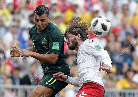 Australia's Andrew Nabbout and Denmark's Lasse Schone, right, battle for the ball during the group C match between Denmark and Australia at the 2018 soccer World Cup in the Samara Arena in Samara, Russia
