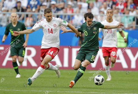 Denmark's Henrik Dalsgaard, left, and Australia's Robbie Kruse battle for the ball during the group C match between Denmark and Australia at the 2018 soccer World Cup in the Samara Arena in Samara, Russia