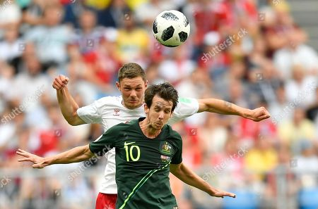 Denmark's Henrik Dalsgaard, left, and Australia's Robbie Kruse go for a header during the group C match between Denmark and Australia at the 2018 soccer World Cup in the Samara Arena in Samara, Russia