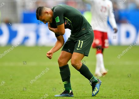 Australia's Andrew Nabbout grimaces in pain after suffering a shoulder injury during the group C match between Denmark and Australia at the 2018 soccer World Cup in the Samara Arena in Samara, Russia