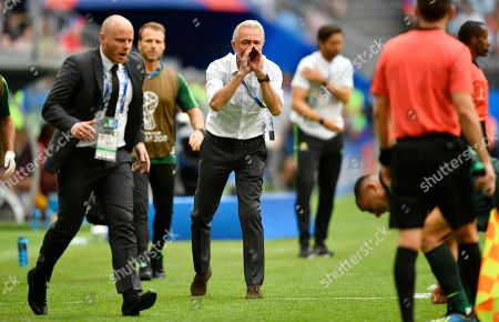 Australia head coach Bert van Marwijk, center, shouts to injured player Andrew Nabbout during the group C match between Denmark and Australia at the 2018 soccer World Cup in the Samara Arena in Samara, Russia