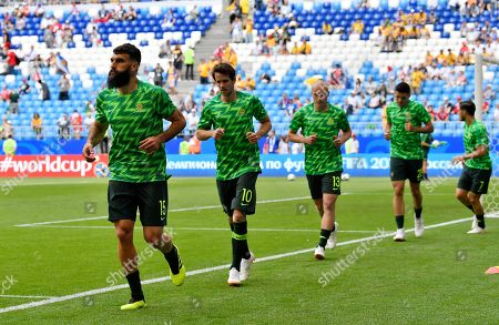 Australia's Mile Jedinak, Robbie Kruse, Aaron Mooy, Trent Sainsbury and Mathew Leckie, from left, warm up prior to the group C match between Denmark and Australia at the 2018 soccer World Cup in the Samara Arena in Samara, Russia