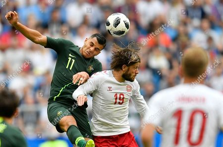 Australia's Andrew Nabbout, left, and Denmark's Lasse Schone go for a header during the group C match between Denmark and Australia at the 2018 soccer World Cup in the Samara Arena in Samara, Russia