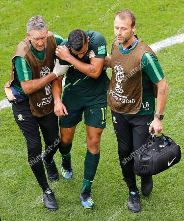 Stock Image of Australia's Andrew Nabbout, centre, leaves the pitch injured during the group C match between Denmark and Australia at the 2018 soccer World Cup in the Samara Arena in Samara, Russia