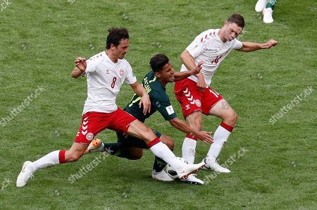 Denmark's Thomas Delaney, left, and Denmark's Henrik Dalsgaard challenge for the ball with Australia's Daniel Arzani during the group C match between Denmark and Australia at the 2018 soccer World Cup in the Samara Arena in Samara, Russia