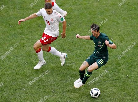 Australia's Robbie Kruse, right, controls the ball ahead of Denmark's Henrik Dalsgaard during the group C match between Denmark and Australia at the 2018 soccer World Cup in the Samara Arena in Samara, Russia
