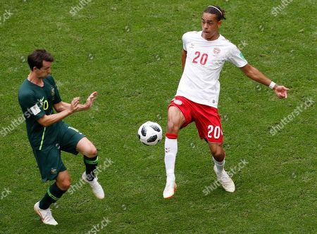 Australia's Robbie Kruse, left, and Denmark's Yussuf Yurary Poulsen challenge for the ball during the group C match between Denmark and Australia at the 2018 soccer World Cup in the Samara Arena in Samara, Russia