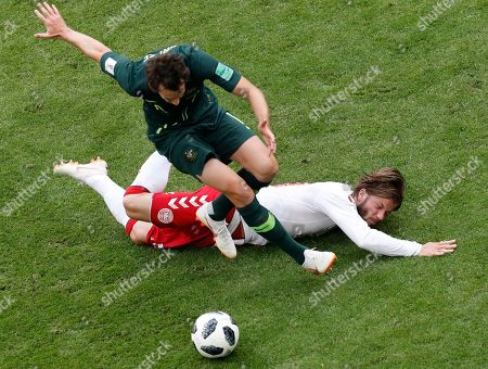 Australia's Robbie Kruse, left, and Denmark's Lasse Schone challenge for the ball during the group C match between Denmark and Australia at the 2018 soccer World Cup in the Samara Arena in Samara, Russia