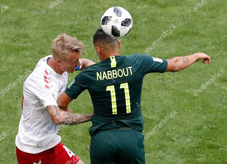 Denmark's Simon Kjaer, left, and Australia's Andrew Nabbout jump for the ball during the group C match between Denmark and Australia at the 2018 soccer World Cup in the Samara Arena in Samara, Russia