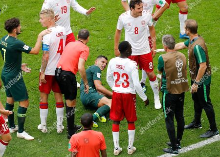 Stock Picture of Australia's Andrew Nabbout, centre, grimaces in pain after suffering a shoulder injury during the group C match between Denmark and Australia at the 2018 soccer World Cup in the Samara Arena in Samara, Russia