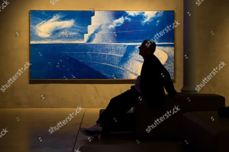 A man looks at some works shown at the exhibition 'Still Blue' in Barcelona, Spain, 21 June 2018. The exhibition shows work of Andy Warhol, Jean Michel Basquiat, Mark Tansey, Lucio Fontana, Yves Klein, Howard Hodgkin, Penck and Joerg Immendorf. The display will be shown from 21 June to 04 November 2018.