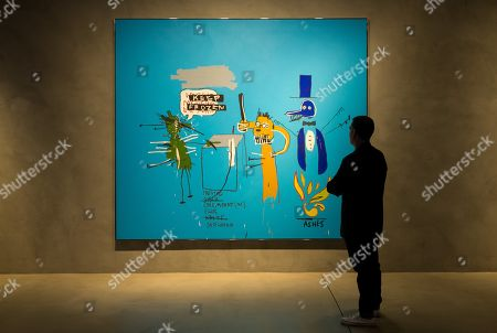A man looks at a work called'The Dingoes That Park Their Brains with their Gum' of Jen-Michel Basquiat at the exhibition 'Still Blue' in Barcelona, Spain, 21 June 2018. The exhibition shows work of Andy Warhol, Jean Michel Basquiat, Mark Tansey, Lucio Fontana, Yves Klein, Howard Hodgkin, Penck and Joerg Immendorf. The display will be shown from 21 June to 04 November 2018.