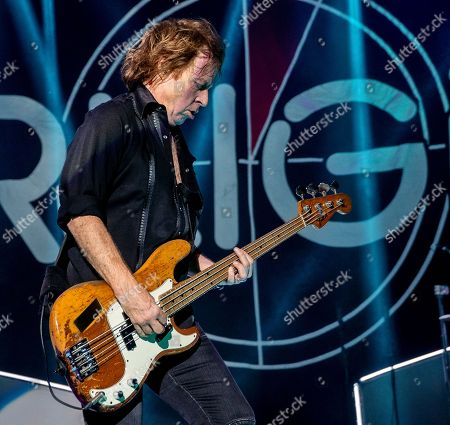 The English-American rock band Foreigner with bass player Jeff Pilson performs at the Blue Hills Bank Pavilion, in Boston as part of The Juke Box Heroes Tour