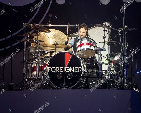 Stock Picture of The English-American rock band Foreigner with drummer Chris Frazier performs at the Blue Hills Bank Pavilion, in Boston as part of The Juke Box Heroes Tour