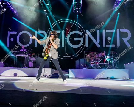 Michael Bluestein, Kelly Hansen, Chris Frazier. The English-American rock band Foreigner with keyboardist Michael Bluestein, lead vocalist Kelly Hansen and drummer Chris Frazier performs at the Blue Hills Bank Pavilion, in Boston as part of The Juke Box Heroes Tour