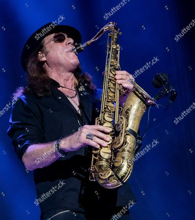 Stock Picture of The English-American rock band Foreigner with sax player Thom Gimbel performs at the Blue Hills Bank Pavilion, in Boston as part of The Juke Box Heroes Tour